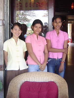 young women in front of hotel