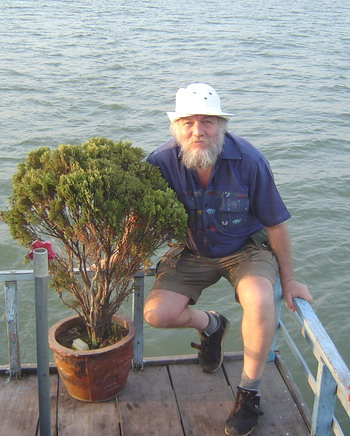 Dave on the boat with the tree