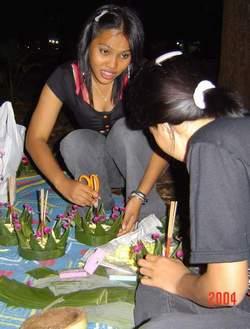 two girls making gratongs