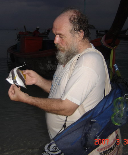 Dave with the dead fish on the shore