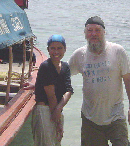 Ann and Dave standing by the boat