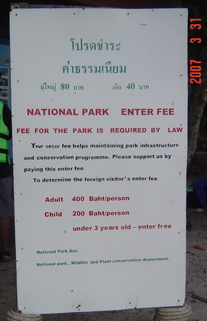 the park sign telling about entrance fees