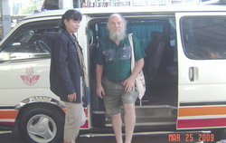 in front of minivan at Hat Yai bus station