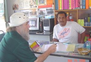 talking to the tour shop operator at Kuala Besut