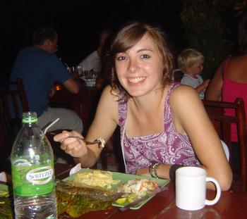 Kelsey enjoying her fish dinner ....