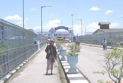 Ann on the bridge across the Sungai Kolok River to Malaysia