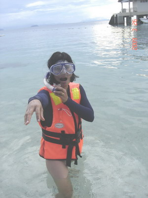 Ann getting ready for some snorkelling in front of Abdul's