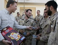 Star pic politician handing out cakes in Afghanistan