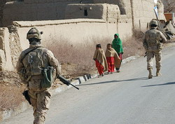 Star pic, soldiers in Afghanistan on road, with kids